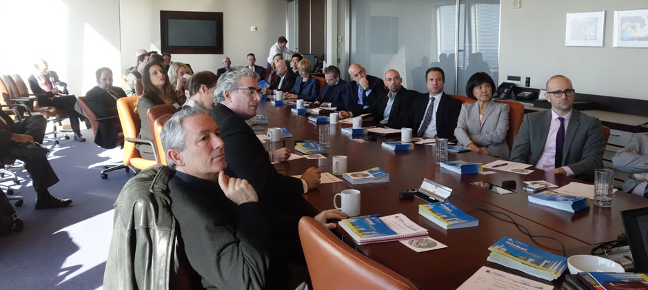The Steering Committee meets in the boardroom of The Durst Organization in the Bank of America Tower