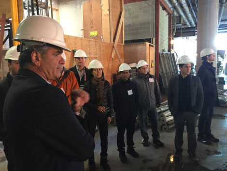 Attendees tour the interior of One Bloor East.
