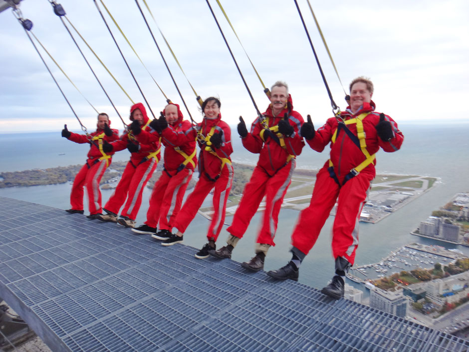 Attendees brave the Edge Walk at the CN Tower.