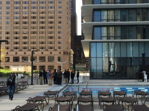The group discusses the design of Aqua Tower from its outdoor podium amenity space.